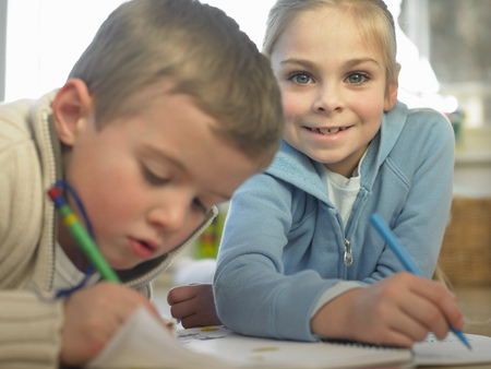 Children drawing together on floor