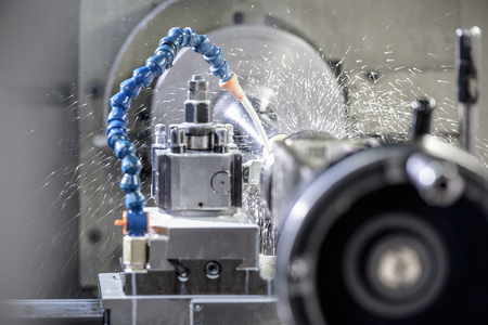 Water spraying on machinery in factory LANG_EVOIMAGES