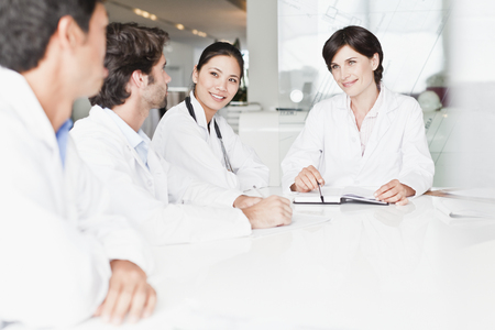 consulted: Doctors talking in meeting