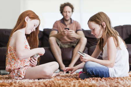 Girls playing cards on living room floor