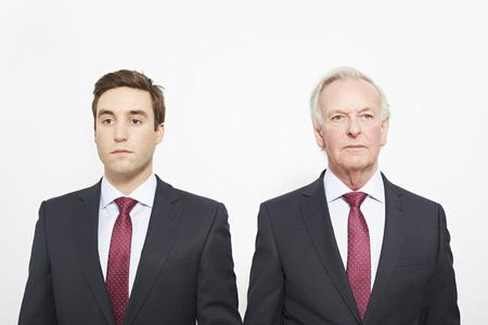 equivalents: Businessmen standing together