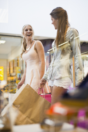commodities: Women window shopping together