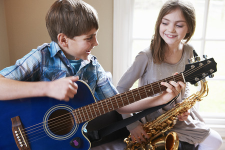 musically: Children playing music together