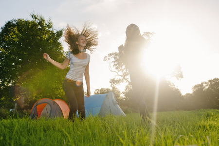 low spirited: Teenage girls dancing in field
