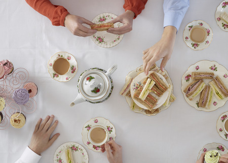 shared sharing: Overhead view of people having tea