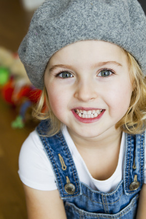 berets: Close up of girls smiling face