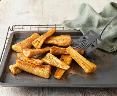 Honey roast parsnips on baking tray with green cloth