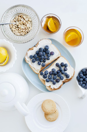 biscuits: Toast with blueberries,nuts and tea LANG_EVOIMAGES