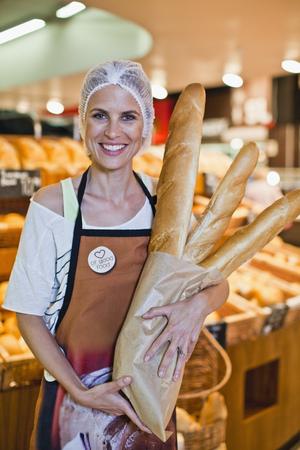 Baker smiling in store LANG_EVOIMAGES