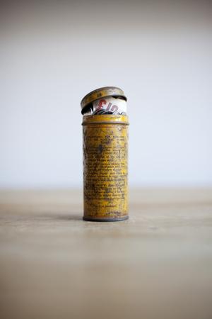 Antique tin full of money on desk LANG_EVOIMAGES