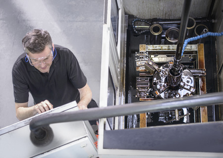 protects: Worker at control panel in factory