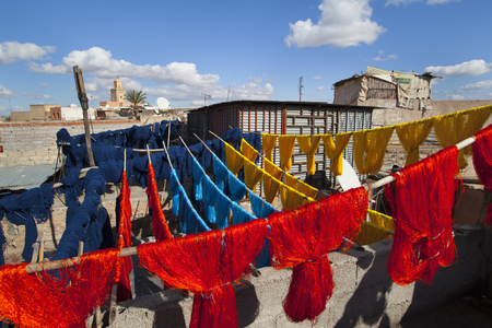 Dyed wool drying on lines
