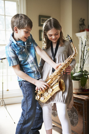 rehearsal: Children playing with saxophone