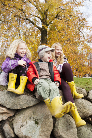 equivalents: Children wearing rain boots outdoors