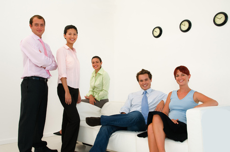 timepieces: Business people smiling in lobby area