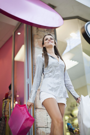 admired: Woman carrying shopping bags
