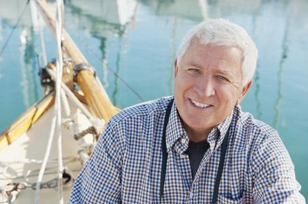 Older man sitting on boat