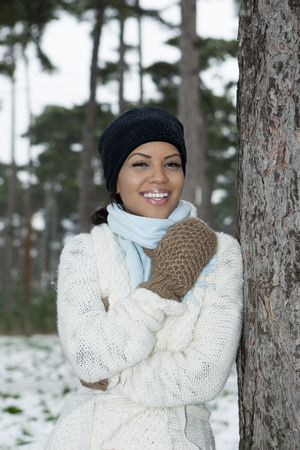 snows: Woman standing in snowy forest
