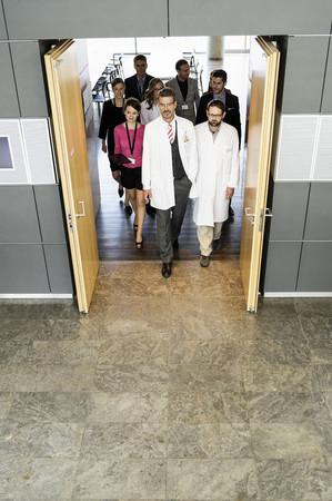 corridors: Business people and doctors in doorway