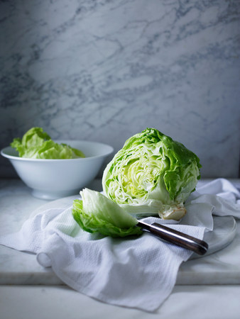 impulsive: Iceberg lettuce on white tea towel