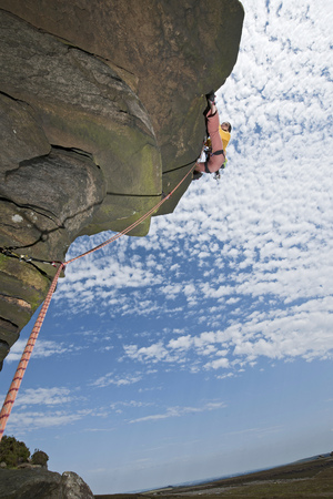 ascends: Rock climber scaling rock formation