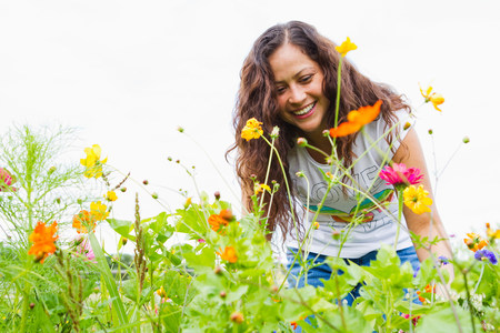 informal clothing: Young woman gardening in allotment