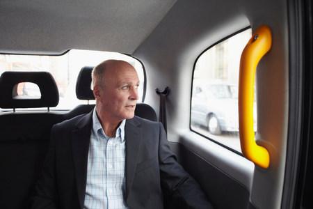 english ethnicity: Mature businessman in black cab,London,England,UK LANG_EVOIMAGES