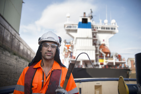 Worker standing on tug boat