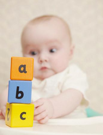 Baby girl with alphabet blocks