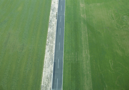 advancing: Aerial view of rural fields and road