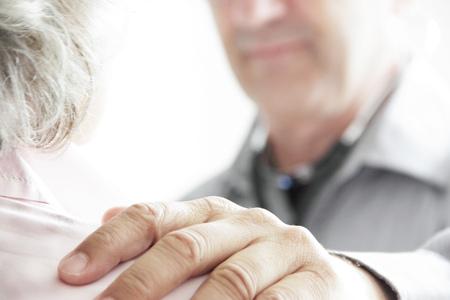 appendage: Doctor with hand on patient's shoulder LANG_EVOIMAGES