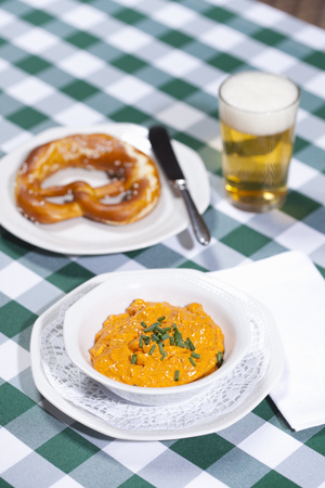 close up food: Cheese soup with beer and pretzel