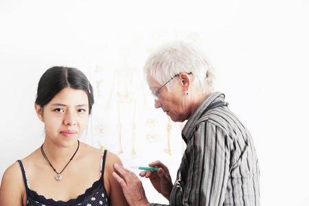 faiths: Doctor giving teenage girl shot LANG_EVOIMAGES