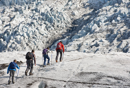 remoteness: Family walking on glacier LANG_EVOIMAGES