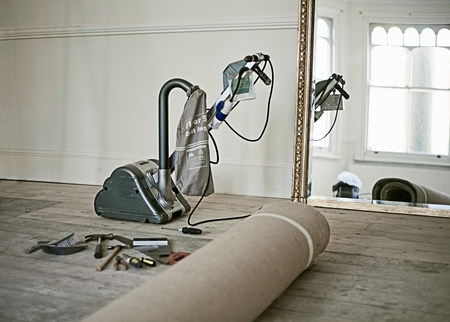 yourself: Floor sander and rolled up carpet in new home LANG_EVOIMAGES