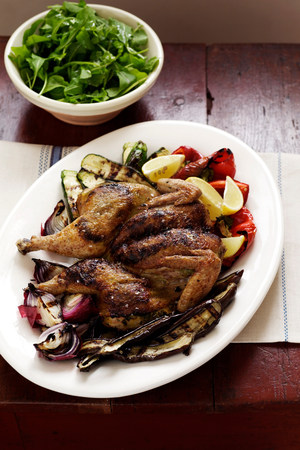 Roast chicken and vegetables on plate LANG_EVOIMAGES