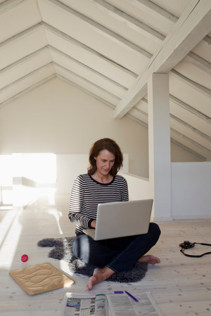 build in: Woman using laptop in loft