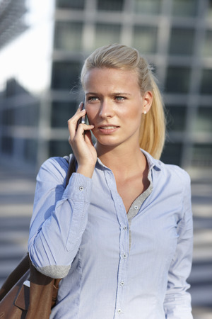 Woman talking on cell phone on street