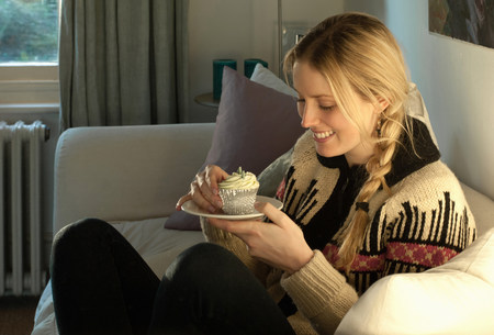 parlours: Woman about to eat cupcake