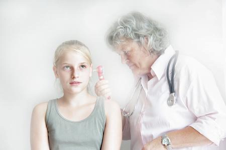 worked: Doctor checking girl's inner ear
