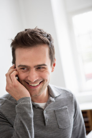 cropped shot: Mature man on telephone call