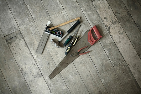 hard: Tools on wooden floorboards of new home