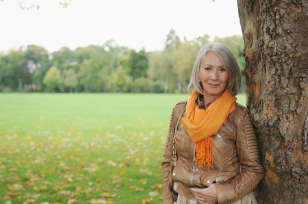 scarves: Portrait of senior woman in park LANG_EVOIMAGES