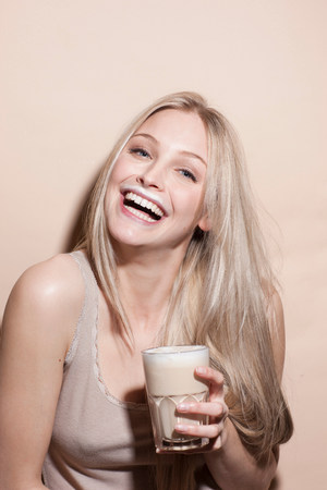 hilarious: Portrait of young blonde woman with milk moustache
