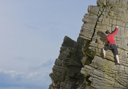 adventuresome: Rock climber scaling rock formation
