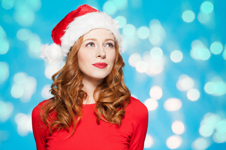 Woman wearing santa hat LANG_EVOIMAGES