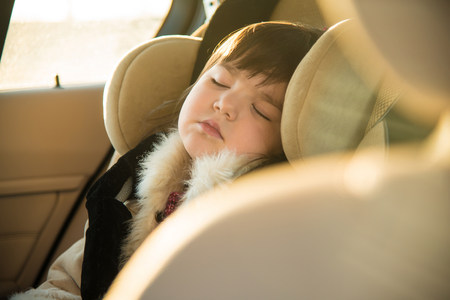 exhausting: Young girl sleeping in car