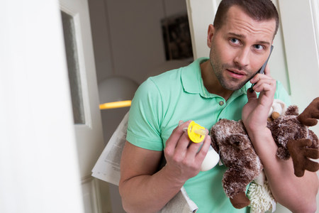 babys dummies: Mid adult man holding cuddly toy and babys pacifier
