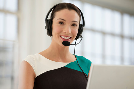 gifted: Female telephonist wearing headset