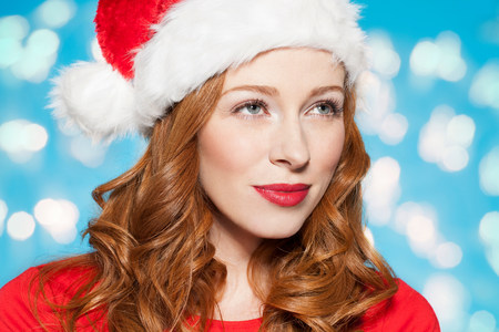 Woman wearing santa hat LANG_EVOIMAGES